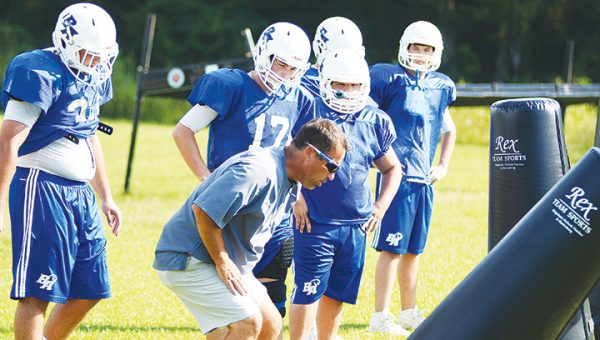 Photo by Anthony McDougle/ Brookhaven Academy head coach Ron Rushing explains a drill to some Cougar lineman during a practice.