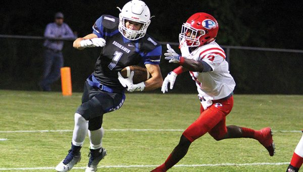 Photo by Sherylyn Evans/ Brookhaven Academy's Logan Murray looks for running room Friday against Parklane.