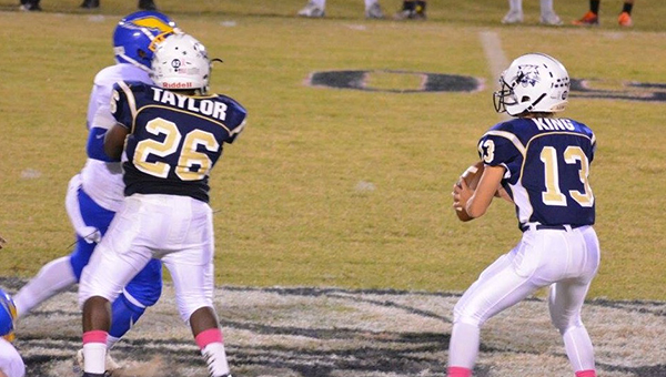 Photo by Stacy Leake\Bogue Chitto Bobcat Chris Taylor (left) guards quarterback Shaw King as he makes a throw.