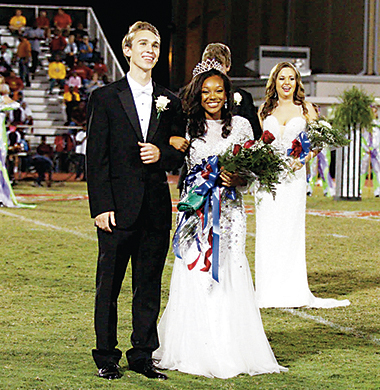 Photo submitted/Dalton Fortado (left) escorts Brookhaven High School's 2016 Homecoming Queen Tia Bussey onto the football field Friday night prior to the school's game against Laurel High School.