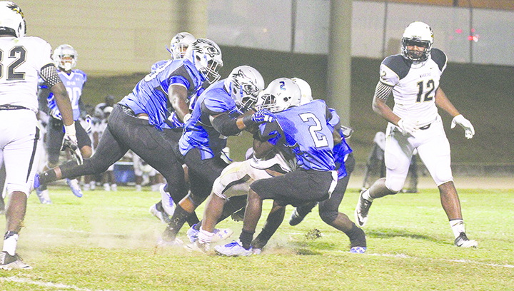 Photo by Lucas Calvert/Freshman Isaiah Swopes and a host of Wolves wrap up an East Central running back in a 34-23 win over the Warriors last week.