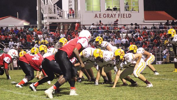 Photo by Christy Boyte/ The Prentiss defense digs in and awaits the snap from the Enterprise Yellow Jackets during their district game Friday night.