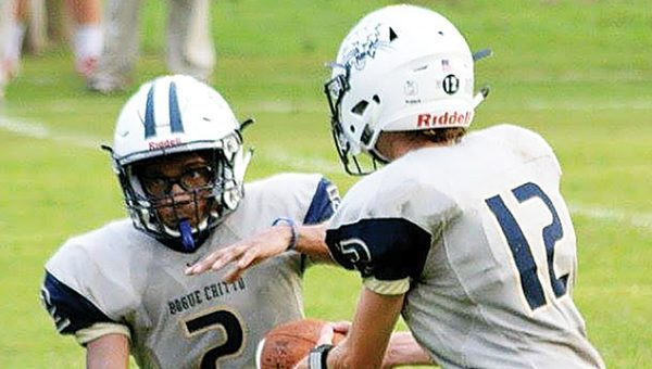 Photo by Stacy Leake/ Quarterback Trey Nettles hands off to running back Demarcus Godbolt during their game against Mount Olive Friday.