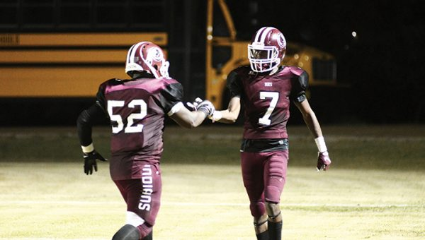 Photo by Anthony McDougle/ Hazlehurst's Jaquaveon Tillman is congratulated by lineman Demetrius Swilley after reeling in a touchdown pass late in Friday's home contest against the Franklin County Bulldogs.