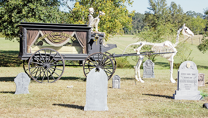 """Photo by Alex Jacks/Those looking for a Halloween adventure prior to Oct. 31 are encouraged to take a ride out to Brian and Beth King's """"Silent Oaks Cemetery,"""" located at 4179 Anderson Road in Wesson. The Halloween Haunt features handmade props fit to scare, including this horse-drawn hearse."""