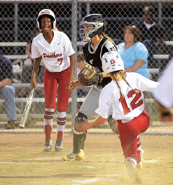 Photo by Anthony McDougle /Ole Brook's Kat Wallace slides safely into home plate in the Panthers' playoff series against Northwest Rankin Tuesday night.