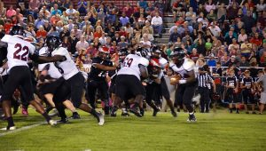 Cougar running back Antwan Pittman (34) attempts to get clear of the Eagle blitz.