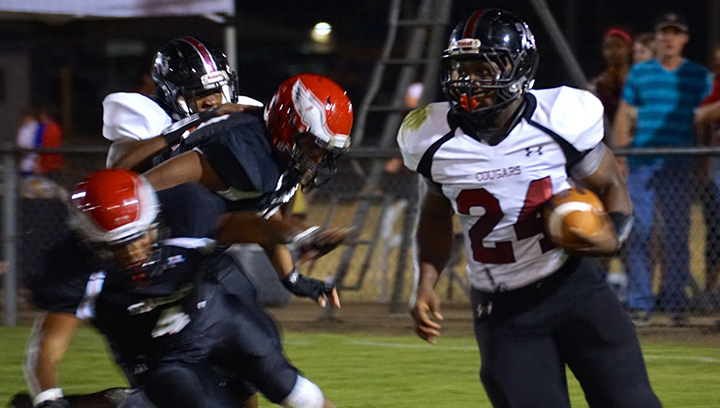 Photos by Jana Harp/Quitten Brown (24) makes a play downfield for the Lawrence County Cougars.