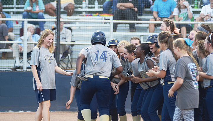 Photo by Anthony McDougle /Lineka Newson approaches home plate as her teammates await her after she hit a home run early in their win over the Bears Thursday.