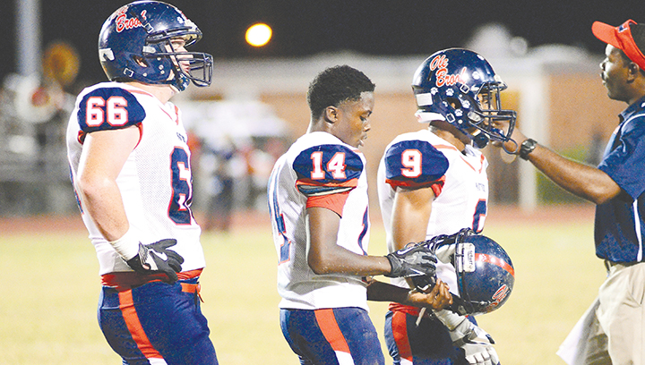 Photo by Anthony McDougle /Freshman quarterback Byrion Robinson (center) will take the helm of the Ole Brook offense tonight.