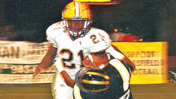 Photo by Christy Boyte/ Enterprise's Darren Richardson tries to break a Bassfield defenders' tackle Friday night in Bassfield.