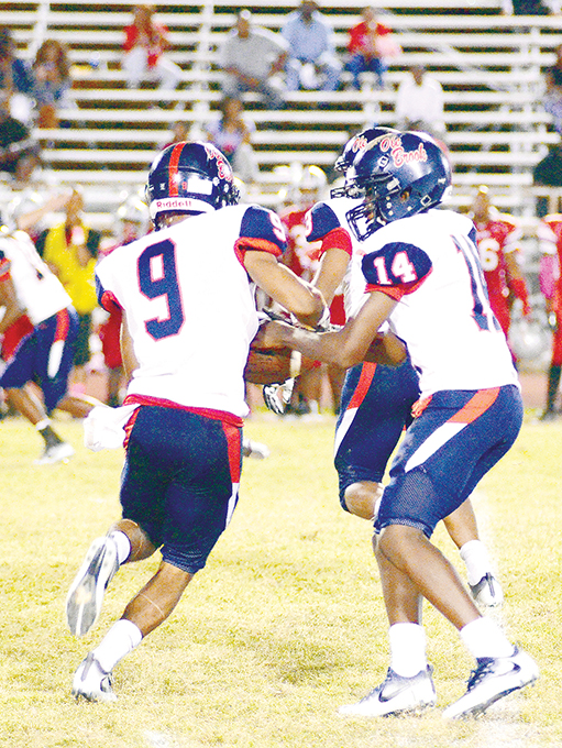 Photo by Anthony McDougle/Ole Brook's freshman quarterback Byrion Robinson hands off to Don Blandon in the Panthers' 13-0 district victory over the Provine Rams Thursday night at Hughes Field in Jackson.