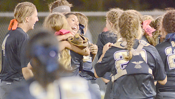 Photo by Anthony McDougle/Members of the Bogue Chitto Bobcats' slow-pitch softball team celebrate at the mound after the final out in Game 3 of the South State championship series Tuesday night.