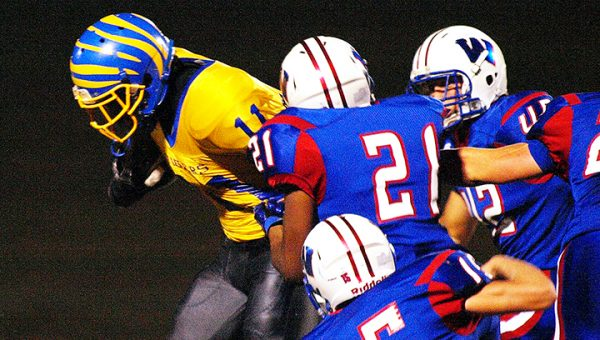 Photo by Tracy Fischer/ A host of Wesson defenders attempt to bring down a Jefferson County ball carrier in a district tilt between the squads Friday.