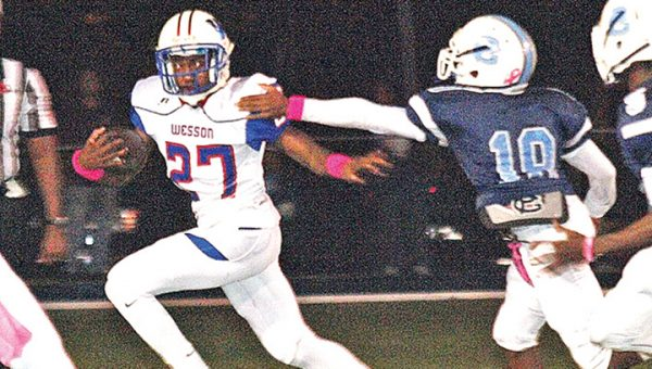 Photo by Tracy Fischer/  Wesson running back/safety Ja'Quavion Harris tries to evade an outstretched  Blue Wave defender in Port Gibson Friday night.