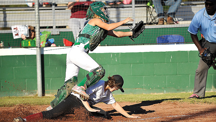 Photo by Teresa Allred/West Lincolns catcher Ashley Tabor misses the tag on a Richton baserunner at home plate in the Bears' first-round playoff series against the Rebels Tuesday.