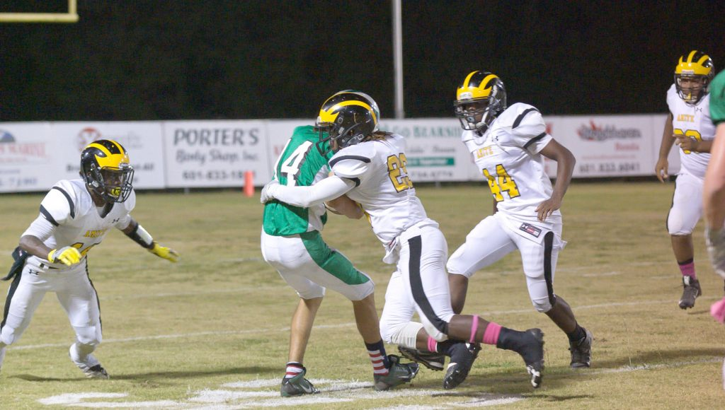 Photo submitted.West Lincoln's Austin Griffin is tackled by two Amite defenders recently. The Bears will face Prentiss Friday.