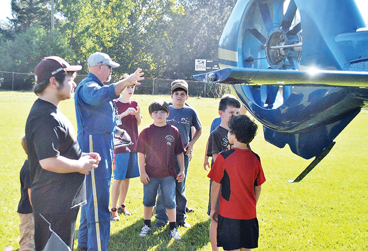 Photo by Aaron Paden/Students from The Reading Nook took a field trip Thursday to the Exchange Club Park to learn about the LifeFlight 4 medical helicopter.