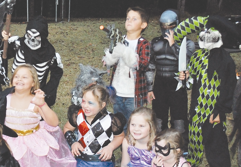 Photo by Aaron Paden/Back row, Garson Haley (left), Case Simmons, Jameson Pannel and  Paxton Leggett; and front row, Chloe Emory, Magnolia Jones, Avery Tanksley and Addie Tanksley make scary faces Saturday at Jones' Scare Away Cancer party. About two dozen of her friends from Brookhaven Academy celebrated the end of her treatment for B-cell acute lymphoblastic leukemia with a Halloween bash at the school.