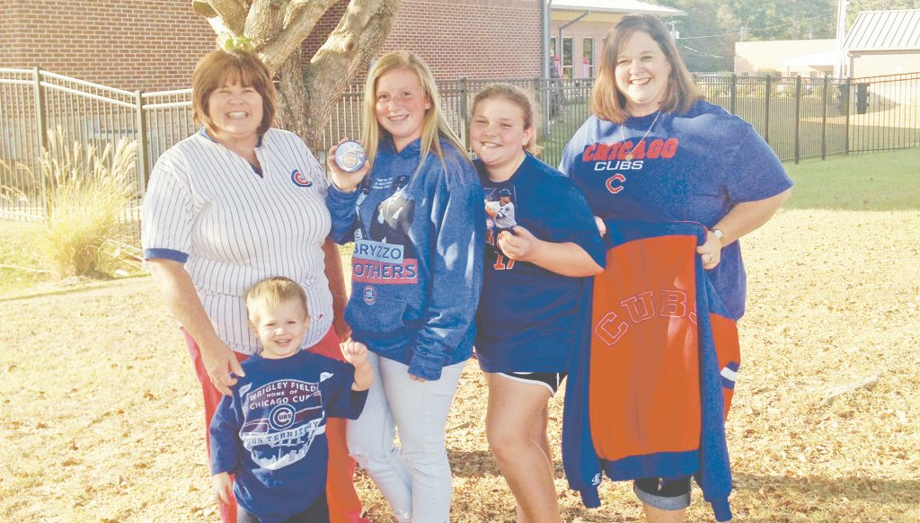 Photo submitted/Diehard Cubs fans Debbie Case (left), Preston Kennedy, Jenna Fuller, Jadeyn Fuller and Dawn Fuller anxiously watched as the team won the World Series Wednesday night in extra innings of game seven, breaking the franchise's 108-year curse. Case and Dawn Fuller became huge Cubs fans thanks to their mother and grandfather. Jenna Fuller holds her grandmother's Cubs pin, a memento the family has kept since her passing for good luck throughout the season.