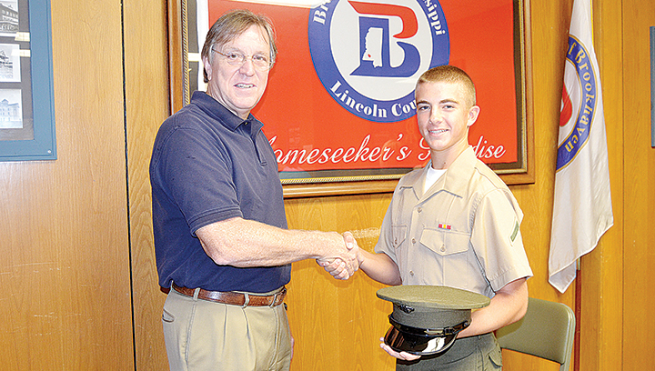 Photo by Donna Campbell/Brookhaven Mayor Joe Cox visits with Bogue Chitto High School graduate Dallas Reid while he was home on leave from his Marine Corps combat training.