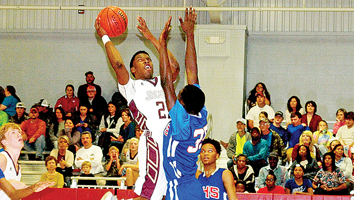 Photo by Tracy Fischer/Enterprise's No. 23 Dwayne Pendleton goes for the net against Wesson's No. 35 Johntavious Smith.