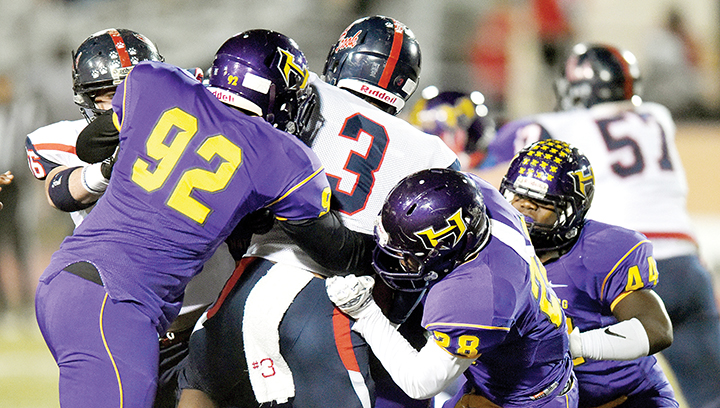 Photo by Susan Broadbridge/Hattiesburg American/ Brookhaven's Kenneth Dixon is stopped by a host of Hattiesburg defenders Friday at Hattiesburg.