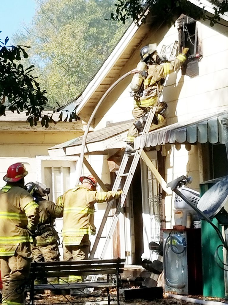 Photo by Donna Campbell/Brookhaven firefighters work to save a home at 1000 East Monticello St. shortly after 10 a.m. today.