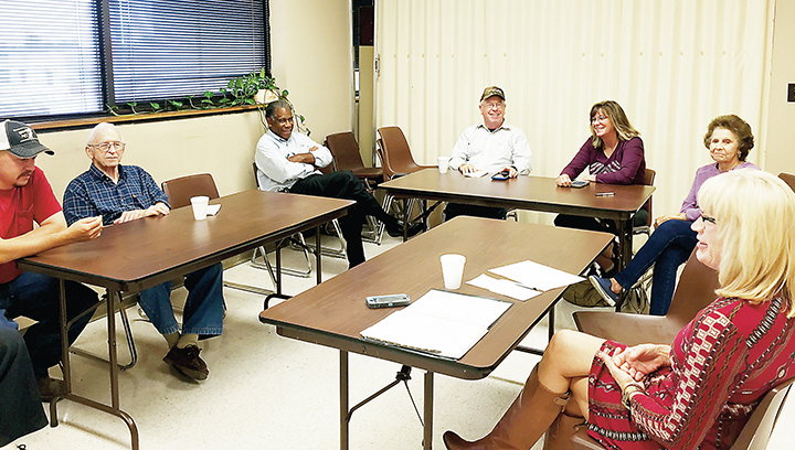 Photo by Alex Jacks/Lincoln County Extension Agent Rebecca Bates (right) recently met with a host of local farmers and vendors to discuss plans for the Thanksgiving Famers Market Tuesday.