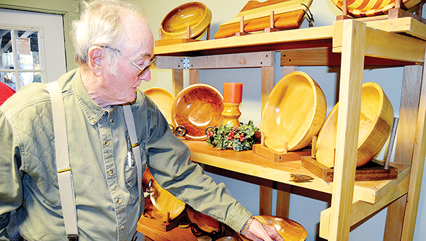 Photo by Donna Campbell/Maurice Smith, of East Lincoln, spent his career in glass. Now he's happiest working with wood.