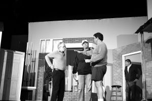 Photo by Julia Miller/Director Doug Hoy, right, shares his vision with Matt Coleman, playing Ebenezer Scrooge, and Eric Brown, playing Ghost of Christmas Present during a rehearsal.