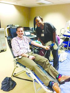 Photo submitted/A Mississippi Blood Services employee checks on a donor at a recent blood drive.