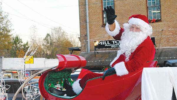 File photo/Santa Claus will ride in the last float of the annual Wesson Christmas Parade Friday. The parade kicks off the town's holiday season.