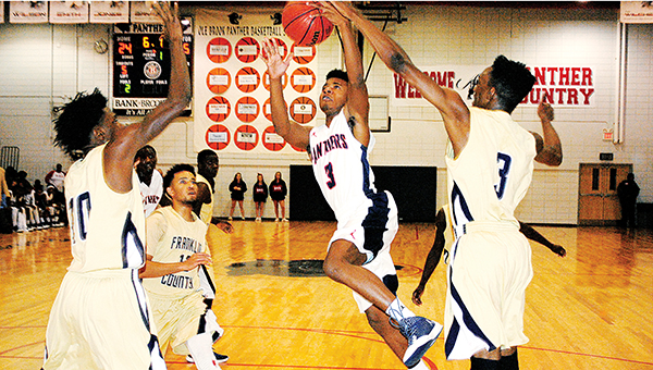 File photo/Brookhaven gurad Shon Blackwell (3) glides through the lane to score a layup in a game last December as Franklin County's Jalon Dogan (3) and Ryan Johnson (10_ tries to deny the play.
