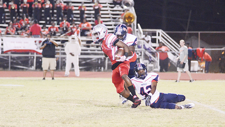 File photo/Brookhaven's Trenton Smith (42) helps pull down a ball carrier earlier in the season. Brookhaven hopes to close out the regular season with a win tonight.
