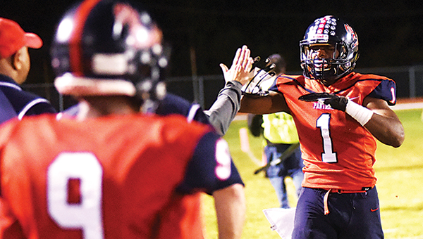 Photo by Ben Hillyer/ Brookhaven's Damarrell Leggett is congratulated on the sideline during Friday's win over Natchez.