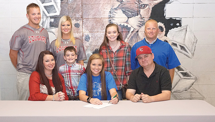 Photo by Jana Harp/Lawrence County softball standout Callie Fortenberry signed a scholarship to play with Copiah-Lincoln Community College Tuesday. Pictured are, front row, from left: Andrea Fortenberry, Callie Fortenberry, Robert Fortenberry; standing, from left: assistant softball coach Marc Howard, head softball Coach Meleah Howard, Wyatt Fortenberry, Gin Fortenberry and athletic director Cory Keyes.