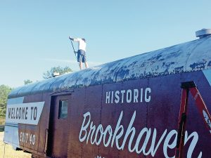 Photo submitted/The Brookhaven-Lincoln County Chamber of Commerce tourism council spent a year working toward transforming an old train car into a welcome sign for interstate travelers. A company was hired to pressure wash, prime, hand paint and clear coat the design to the train car.