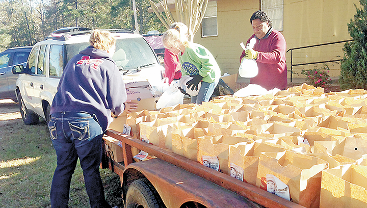 Photo  submitted/Volunteers at the Doll's House spent Saturday giving out more than 200 Thanksgiving boxes to local residents in need.
