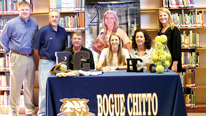 Photo submitted/Bogue Chitto senior Terrah Nelson recently signed a softball scholarship with Southwest Mississippi Community College.  Nelson's plans for college are to major in pre-medicine and enter the medical field in some aspect one day.  During her senior year, Nelson has been selected as Miss Bogue Chitto, the Wendy's Heisman scholar, and the DAR Good Citizen.  She was also honored as a 2016 MHSAA fast-pitch and slow-pitch all star.  She is pictured with her parents, Gary and Kim Nelson of Bogue Chitto.  Also pictured with Terrah are her coaches, Scott and Denise Leggett, and principal, Jay Rayborn.