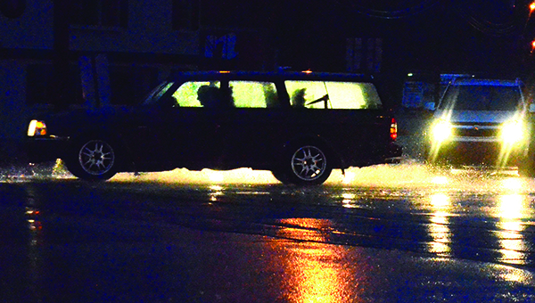 Photo by Luke Horton/A motorist makes his way down Hwy. 51 in a downpour Monday evening. Monday marked the first time in several weeks that significant rainfall fell in the area.