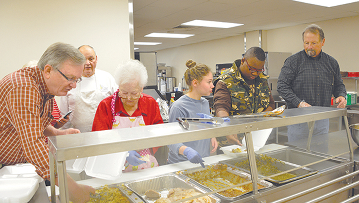 File photo/ Rev. Wayne Webster of First United Methodist Brookhaven (left) oversees a team of volunteers at a previous Doug Sullivan Community Thanksgiving Lunch held at the church's Ministry Center. A free lunch will be served Thanksgiving day at the center from 11 a.m. to 1:30. Carryout meals and deliveries will be available.