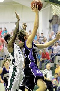 Photos by Sherylyn Evans/BA's Ethan Nations goes up for the shot with Central Hinds' Ronald Williams close behind.