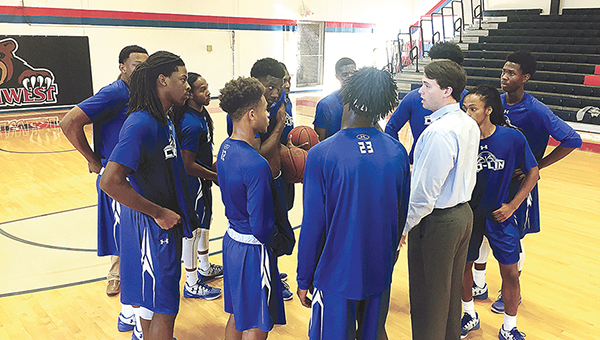 Photo submitted/Assistant coach Jake Reed addresses the Copiah-Lincoln Community College Wolfpack prior to tipoff against Baton Rouge Community College at the Southwest Coca-Cola Tournament recently.