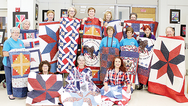 Photo submitted/Stitchers with the Brookhaven Piecemakers Quilt Guild surprised a group of area veterans with patriot-themed quilts for Christmas. With their donations are back row, Maralyin Hudson (left), Sue Thorton, Pat Chandler, Ellen Williamson, Pam Clark, Connie Anderson and Jan Luter; middle row, Jacki Coons, Cathrine Taylor, Evelyn Wilson and Billie Knight; and front row, Doris House, Thomas Ann Gatlin and Melissa Allred.