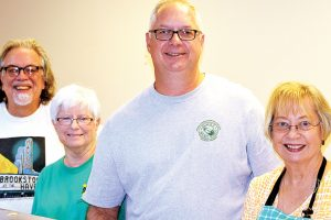 Photo by Kristopher Coleman/Shaw Furlow (left), Betsy Ranson, Bruce Gray and Kathleen Smith were all smiles while serving food at the lunch.