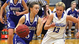 Photo by Sherilyn Evans/BA's Shelby Flumm drives down the court in Saturday's game.
