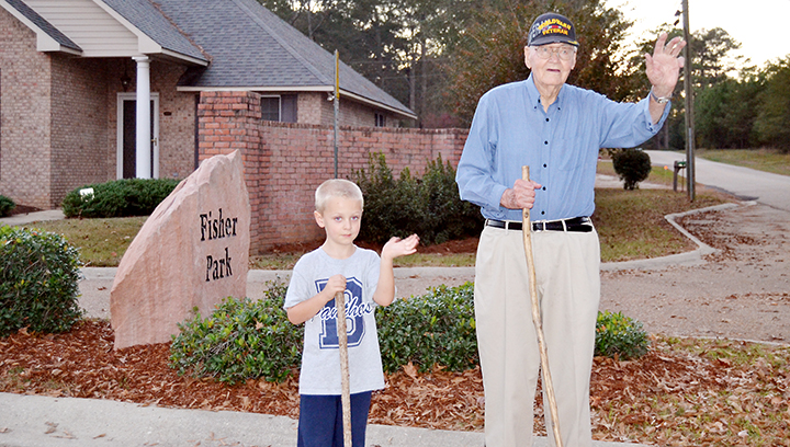 Photo by Donna Campbell/Cecil Rhodes, 96, and Carson Barrington, 5, have been walking partners in Fisher Park for three years. They regularly wave to motorists passing by on Halbert Heights Road in the afternoons. Carson is the son of Steve and Laura Barrington of Brookhaven.