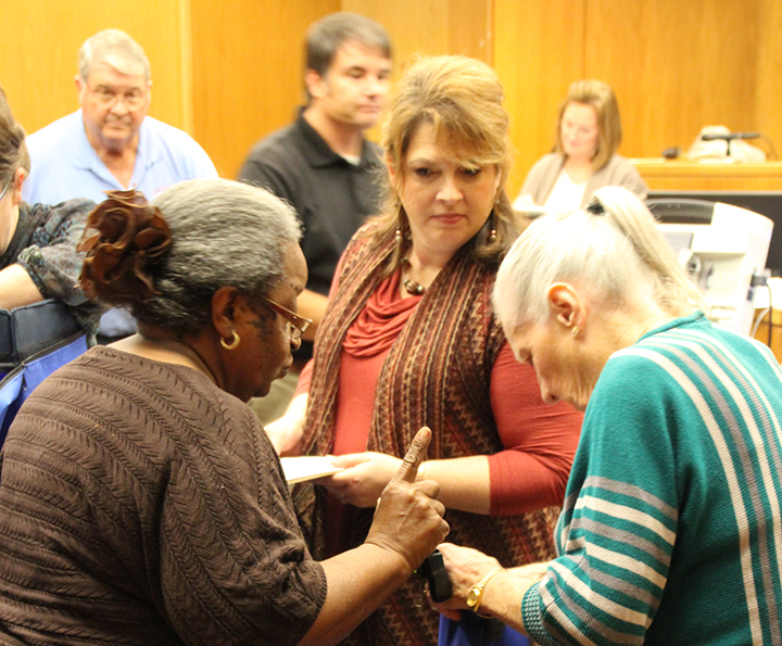 Photo by Alex Jacks/Election officials open a precinct box Tuesday night at the Lincoln County Government Complex.