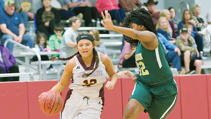 Photo by Teresa Allred/Enterprise's Courtney Greer dribbles down court in a 64-29 win against the McLaurin Lady Tigers Tuesday. McLaurin forfeited the boys game after the McLaurin coach was ejected for arguing with a referee.
